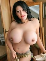 Super busty Latina Ana poses huge tits at the pool