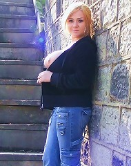 More outdoors flashing from tara sparx wearing jeans and a top
