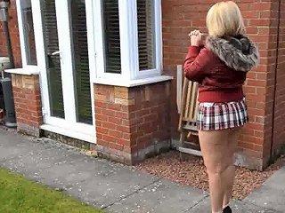 Mature Neighbor Walks With Short Skirt And Bare Ass