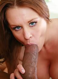 Ebony slut rides a black cock until it nuts deep inside her