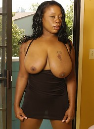 Horny black babe bounces huge juggs while dick-riding!