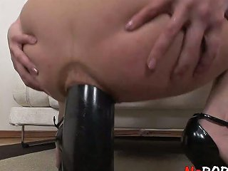 Happily Smiling Nympho Janna C Has Got A Huge Dildo For Her Anus Only