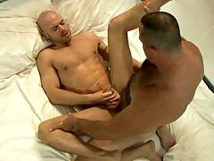 Big hairy daddy Tim Kelly gets his uncut cock sucked then fucks