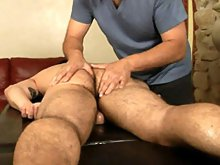 Cute hunk gets massaged by a horny older gay Jake