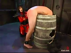 A Brunette In Red Latex Bodysuit Humiliates And Tortures A Guy