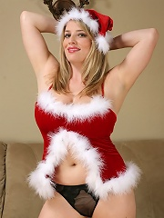 Very busty MILF Maggie spreading early Christmas cheer!
