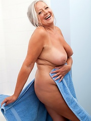 Mature milf loves to pamper her huge tits with lotion