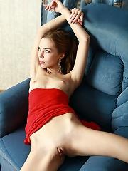 Skinny petite blonde spreading her long legs