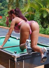 Sexy T-girl sticks pool ball...