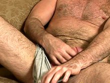 Muscle gay bear plays with his dick