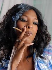 Naughty ebony TS babe smoking a cigarello